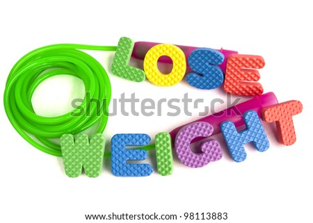 Lose weight concept - colorful sign with alphabet puzzle letters and a jump rope isolated on white background - stock photo