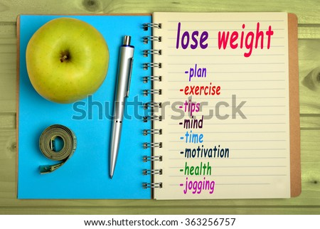 Lose weight words on notebook - stock photo