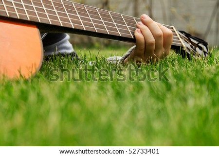loseup of a boys hand with a guitar - stock photo
