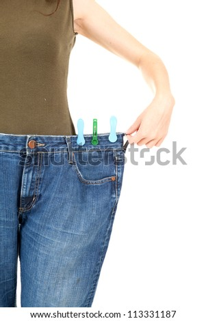 losing weight, anonymous woman showing how much weight she lost, white background - stock photo
