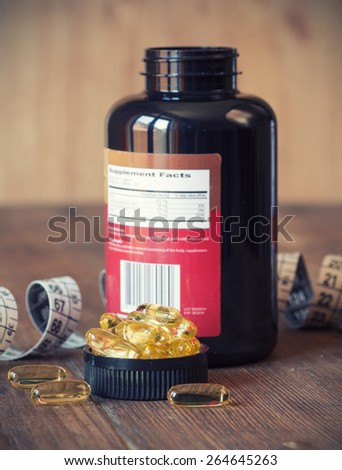 losing weight concept omega 3. Selective focus, shallow DOF - stock photo