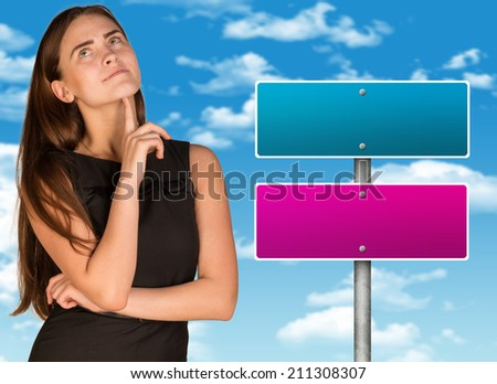 Lost in thought businesswoman - stock photo