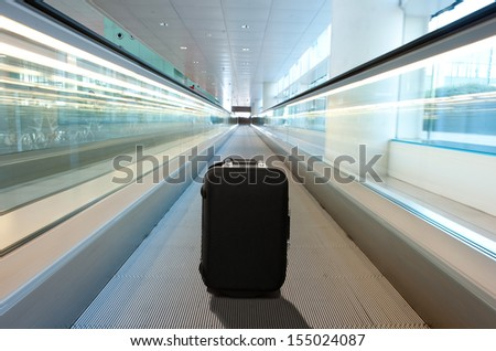 lost suitcase at the airport - stock photo