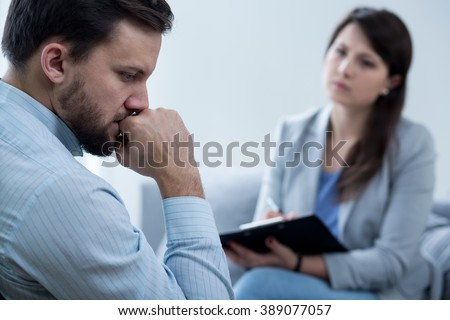 Lost worried middle aged man on individual psychotherapy - stock photo