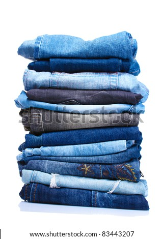 lot of blue jeans isolated on white - stock photo
