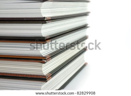 Lot of books on white background - stock photo