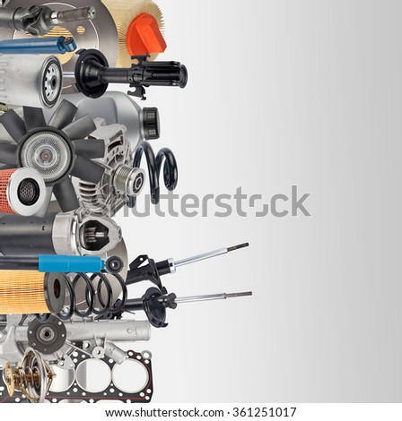 Lot of car spare parts with place for text on white - stock photo