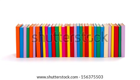 Lot of colorful books in a row on white background - stock photo