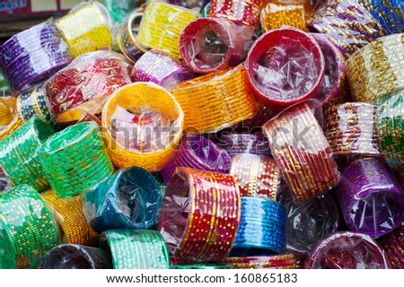 Lot of colorful cheap bangles at Indian market place - stock photo
