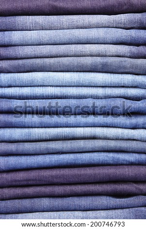 Lot of different blue jeans isolated on white  - stock photo
