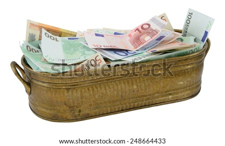Lot of Euro banknote in the brazen container isolated on white. - stock photo
