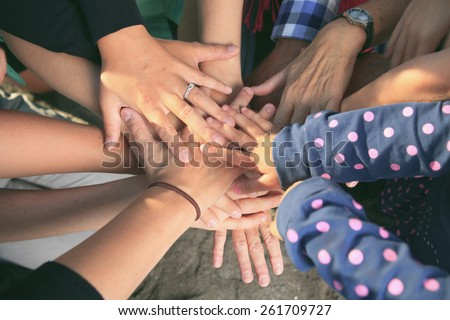 Lot of hands together one over the other. - stock photo