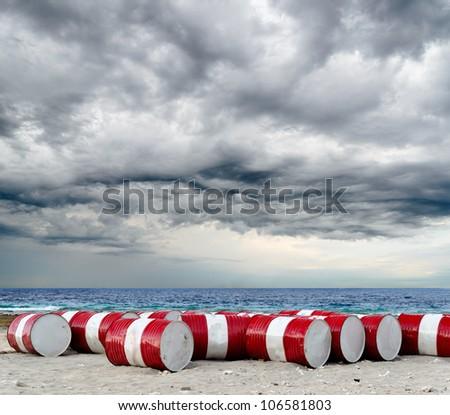 Lot of oil barrels on a seashore. Environment pollution. - stock photo