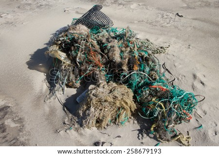 Lot of rubbish washed up on the shore on the beach - stock photo