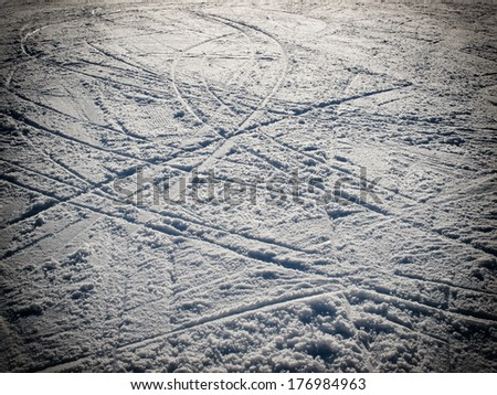 Lot of ski traces on the ski slopes. - stock photo