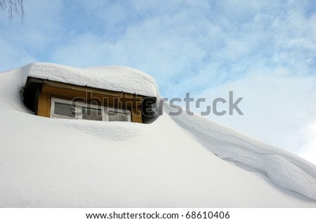 lot of snow on the roof at winter - stock photo
