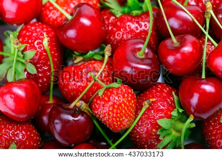 lot of strawberries and cherry as background - stock photo