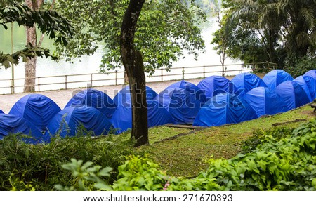 lot of tourist tents in a summer park - stock photo