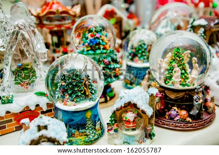 Lot of various snow globes on the table - stock photo