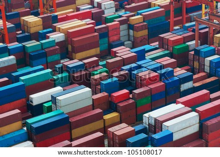 Lot's of cargo freight containers in the Hong Kong sea port. - stock photo