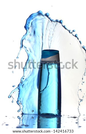 lotion with blue splashes - stock photo
