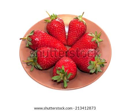 Lots of berries ripe strawberries on brown platter - stock photo
