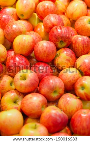 Lots of bright apples in supermarket - stock photo