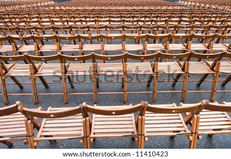 Lots of chairs. Wide angle view. - stock photo