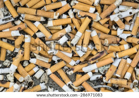 Lots of cigarette buds in a large ash tray - stock photo