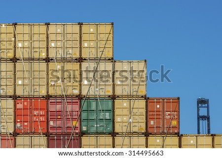 Lots of Colorful Cargo Containers. Industrial Background. - stock photo