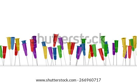 Lots of colorful medical needles on a white background. - stock photo