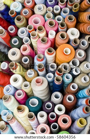 lots of colorful spools of thread - stock photo