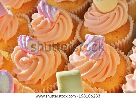 lots of Cupcake's with yellow swirl sugar butter icing  - stock photo