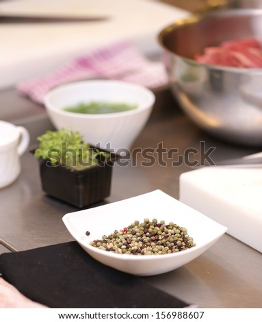 Lots of different vegetables and a small amount of meat put in different dishes - stock photo