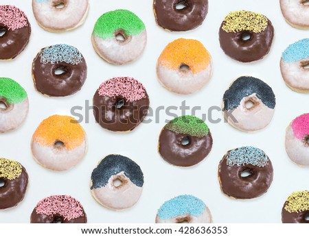 lots of donuts in rows, pattern made of donuts - stock photo