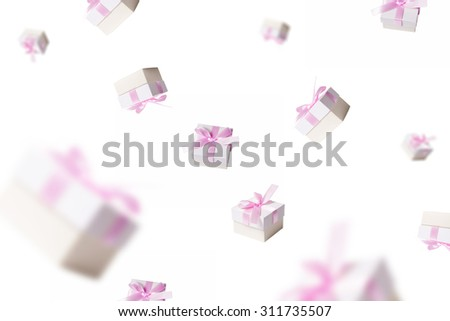 lots of gifts falling from the sky,on white background. - stock photo