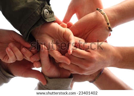 Lots of hands meet in the middle - stock photo