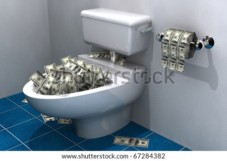 lots of hundred dollar bills in a toilet bowl about to be flushed - stock photo