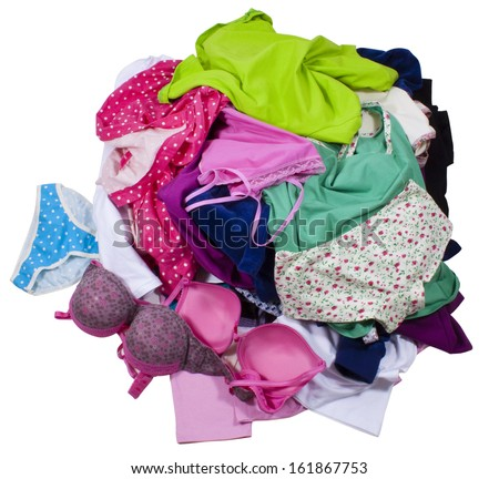 Lots of messy colorful clothes isolated on white background. Clipping paths included. - stock photo