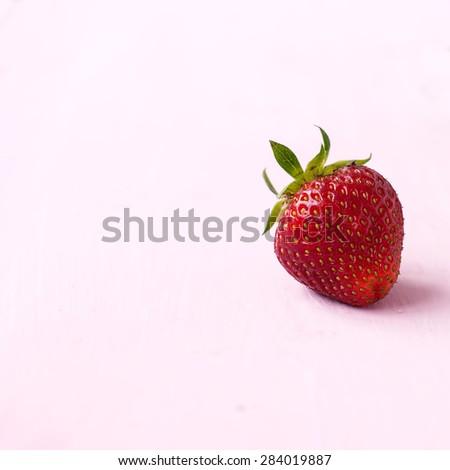 Lots of ripe red juicy strawberries on a blackboard - stock photo