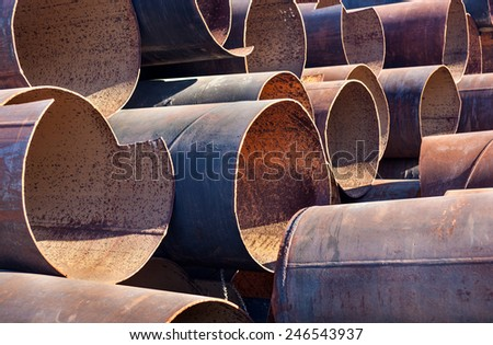 Lots of rusty metal pipes put together. - stock photo