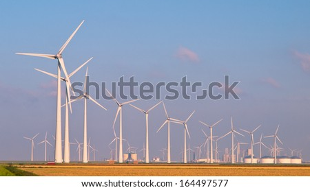 Lots of Three Megawatt Wind Turbines in a Windfarm on the Horizon - stock photo