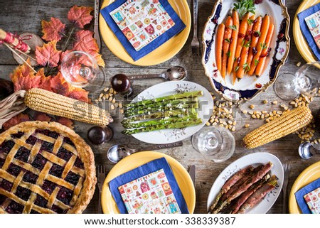 Lots of traditional festive food on wooden table. Thanksgiving dinner. Depth of field   - stock photo