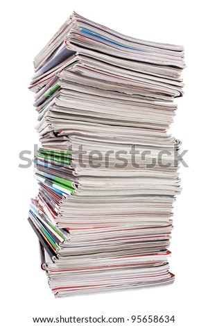 Lots of used magazines on white background - stock photo