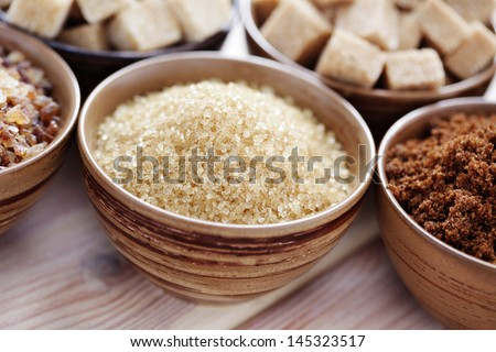 lots of various brown sugar - food and drink - stock photo