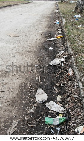 Lots of various garbage lying on the street - stock photo