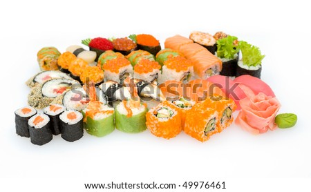 lots of various Japanese sushi and sushi rolls, shallow DOF - stock photo