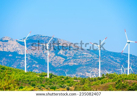 lots of windmills in the mountains - stock photo