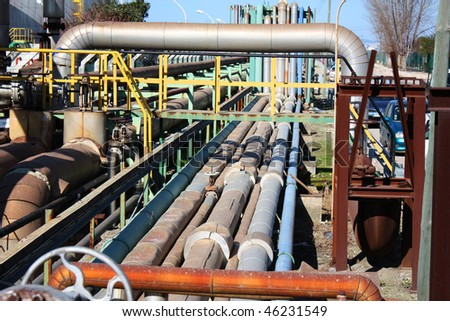 Lots os industrial pipes with different sizes and colors - stock photo
