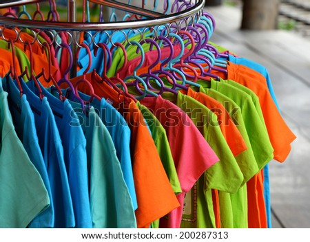Lots shirts on plastic hangers - stock photo